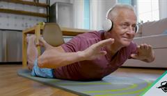 senior man exercises on yoga mat